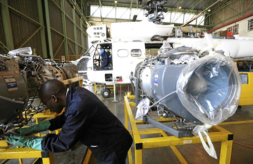 A mechanic works on an Oryx helicopter engine in a workshop hangar on the Denel Aviation site in Boksburg. Picture: KEVIN SUTHERLAND