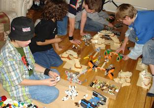 Photo: A group of boys gathered around Star Wars LEGO®