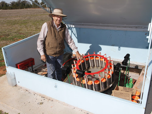 Narrabri Clay Target Club president Barry Thomson loads clays into the automated 'trap' which will send the targets into the sky at the weekend's annual club shoot.