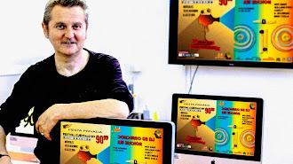 Luis Serrano, director de EISO, con los carteles de los festivales de cortos y DJ.