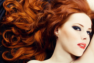 Photo: Beautiful sexy woman with red hair