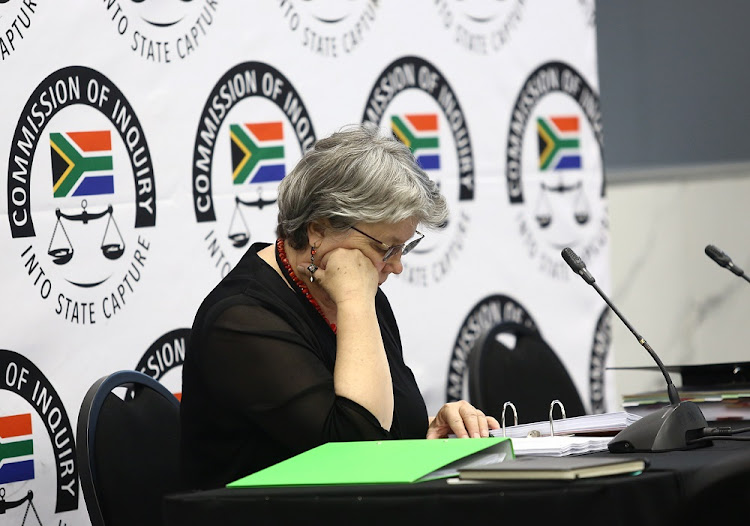 Former public enterprises minister Barbara Hogan goes through her bundle of evidence at the state capture inquiry before giving evidence for the third day.