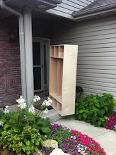 """Photo: Moving the cabinets up was harder than I expected. 3/4"""" birch plywood is heavy!"""