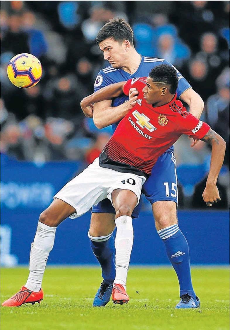 Manchester United's Marcus Rashford, tight, in action with Leicester City's Harry Maguire on Sunday.