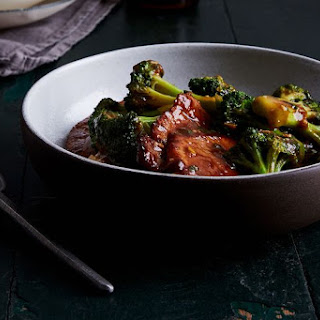 Pan-Fried Pork Chops with Scallions and Broccoli.