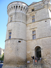 "Photo: A better view of the chateau, rebuilt in 1525 by Bertrand de Simiane. with elements of both medieval and Renaissance architecture. The machicolated towers contain terraces for artillery. Three stories of ""Renaissance windows"" were added in the tall curtain walls, and arrow slits can be seen on all the surfaces of the construction: towers, walls and bartizans (wall mounted turrets - part of one can be seen on the extreme upper right)."
