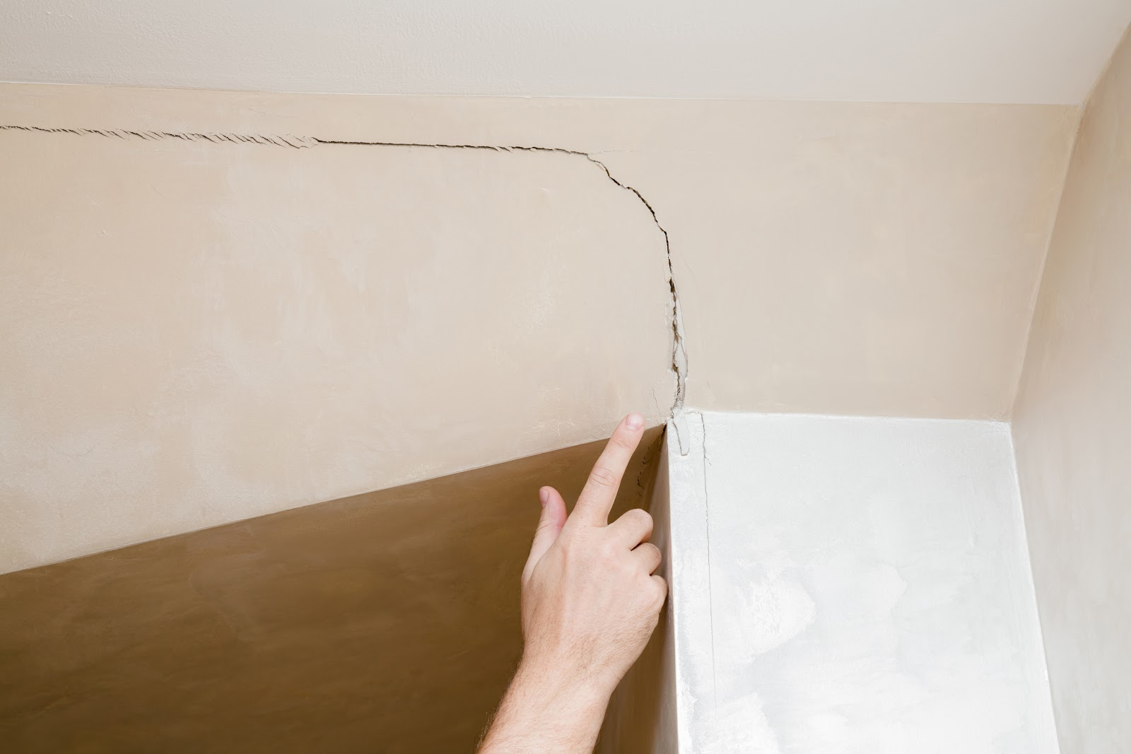 crack in wall from construction defect