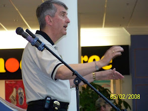 Photo: Murray Phillips directing Massed Sing - County Fair Mall, New Minas