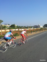 Photo: Arvind Bhateja and Kiran Kumar Raju after being distanced from the peloton