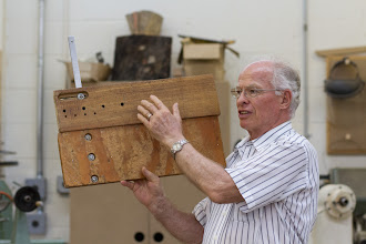 Photo: Phil Brown explains his adjustments for his circle cutting jig for the band saw.
