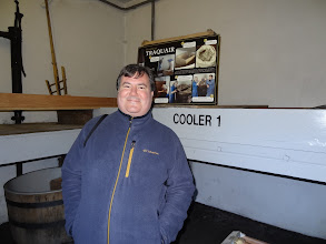Photo: Fred Crudder, beverage manager for Taco Mac, poses in front of the old wort coolers at Traquair House in Scotland.