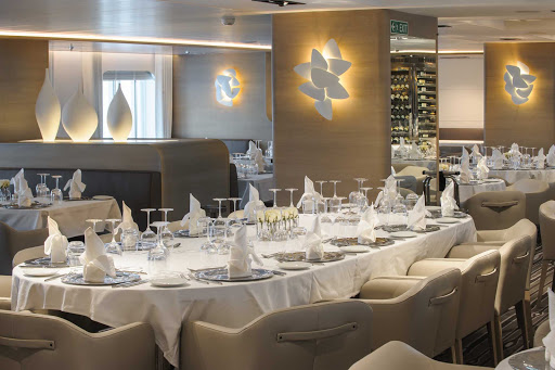 Ponant-dining.jpg -  Dine on French fusion cuisine, such as carpaccio of yellow fin tuna or pan-fried filet steak and finish your meal with panna cotta with red berry fruits on your Ponant sailing.