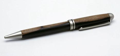 "Photo: #18 - Carl Powell - Pen - .5"" x 5.5"" - Ebony"