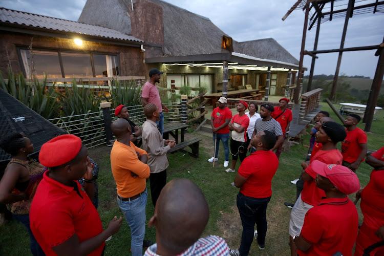 EFF members on at the farm owned by Anele Hoyana's killer, Fritz Joubert, outside East London.