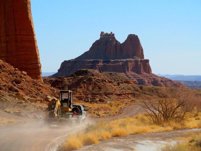 Rancher hauling a small excavator near Birch Spring