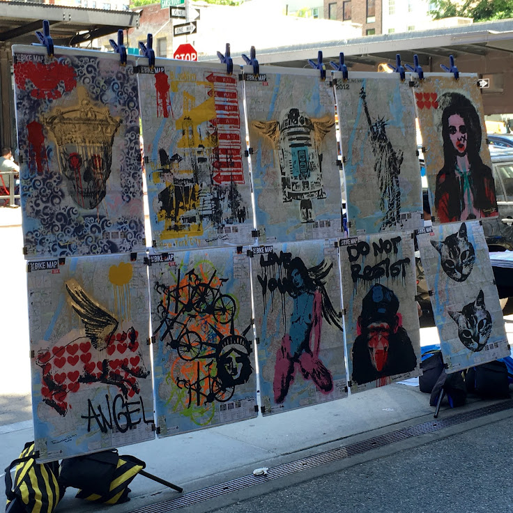 Street art-inspired prints on sale at the entrance.