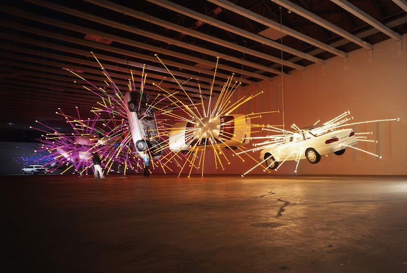 Photo: Cai Guo-Qiang,  Inopportune: Stage 1 (2004) cars, programed multi-color light tubesat MASS MoCA, North Adams, Mass.