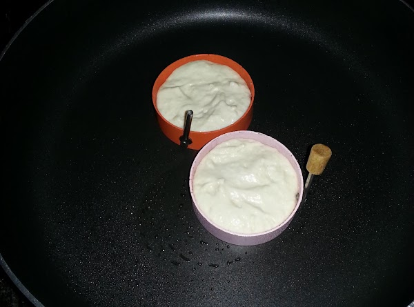 Using the egg fry rings add 1 tablespoon of batter (drizzle with pancake syrup...