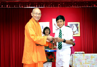 Photo: Sivaraji who has done well in PSLE receiving the Award from Swamiji