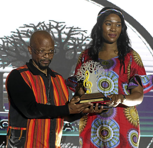 Sello Galane receives his Lifetime Achievement award from MEC Thandi Moraka.