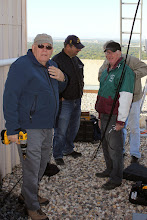 Photo: Ted, Glen, Dennis and Roy planning the coax install