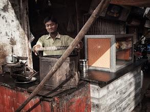 Photo: Man preparing his food stall in Mumbai, India. www.michiel-delange.com