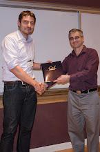 Photo: Max Balandat accepting the EECS Outstanding GSI Award.