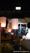 Photo: Lighting and launching lanterns at the wedding
