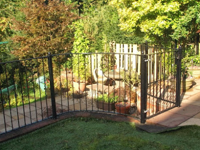 Curved Metal Railings And Small Gate