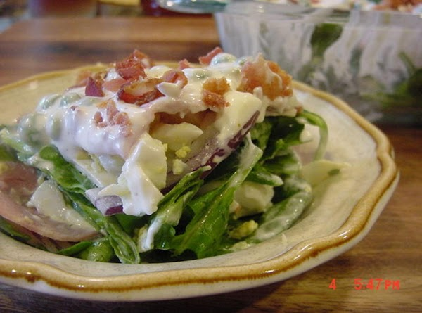 MAKING THE SALAD: Combine the sour cream, mayonnaise, sugar and salt and pepper to taste,...