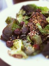 Photo: Urfa Biftek (grilled sirloin, urfa pepper, cumin, baby lettuces, caramelized sesame)