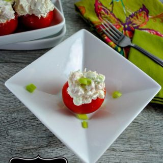 Cocktail Tomatoes Stuffed with Chicken, Goat Cheese, and Green Onion.