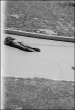 Photo: Jeffrey Miller lies dead after being shot in the mouth by the National Guard some 265 feet away.