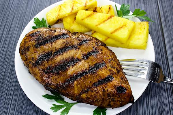 Honey Balsamic Grilled Chicken Breast On A Plate With Grilled Pineapple.