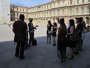 Photo: Jovi explaining the stages of the development and uses of the Louvre