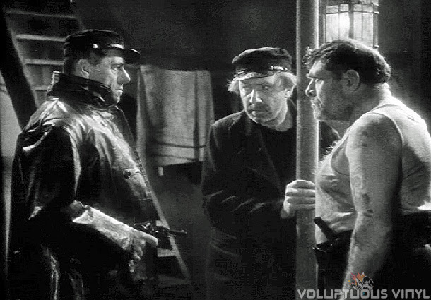 Murder is afoot on the Mary Celeste, Bela Lugosi held at gun point.
