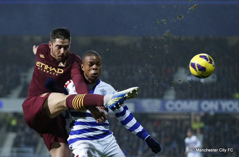 Photo: Queens Park Rangers' Loic Remy, right, competes for the ball with Manchester City's Javi Garcia during the English Premier League soccer match between QPR and Manchester City at Loftus Road stadium in London, Tuesday, Jan. 29, 2013. (AP Photo/Matt Dunham)