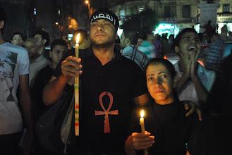 Photo: Mina Daniel's sister joins the candle light vigil in Talat Harb Square.