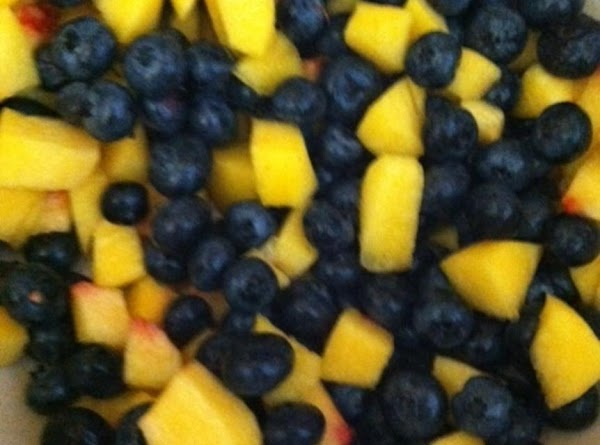 Mix the blueberries with the chopped peaches. Toss peaches,and berries in 1 tablespoon of...