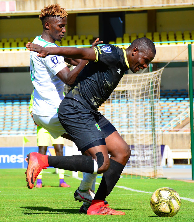 Kenneth Muguna of Gor Mahia challenges Zoo Kericho's Pascal Ogweno during a Premier League match at Moi Stadium, Kasarani