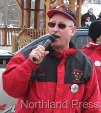 Photo: Event chairman and emcee  Jaime McDonald introduced  the parade participants  - photo by Joanne Boblett