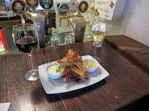 Photo: Wine and fried bread snacks