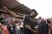 Usain Bolt wows the  crowds in Johannesburg on Monday.
