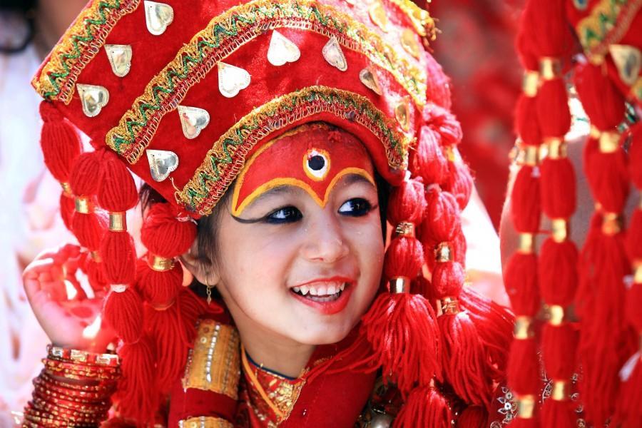 https://trekroute.com/wp-content/uploads/2015/01/Kumari-Nepal-Living-Goddess-e1438591496861.jpg