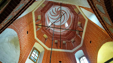 Photo: The walls of the church are painted to imitate brickwork. In its dome, an imitation brick spiral, a symbol of eternity, is to be seen.
