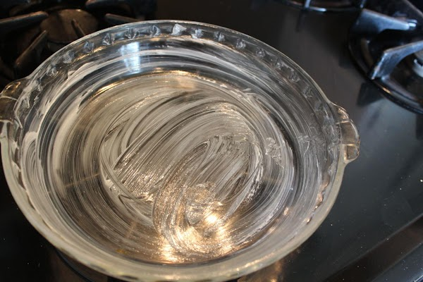 Butter a deep dish glass pie dish.  Preheat oven to 350.