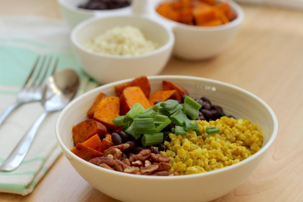 Side view of Black Bean and Sweet Potato Bowl with Turmeric Cauliflower Rice