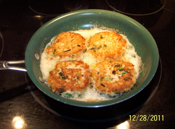 In a large saute pan, melt butter on low. Add salmon patties., ans saute on...