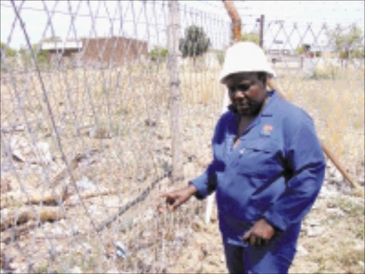 NO BARRIER: Impopeng Fisheries' Mokgadi Moloto wants better fencing.Pic. Unknown.