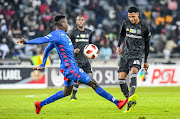 Vincent Pule of Orlando Pirates passes under pressure during the MTN 8 quarter final match between Orlando Pirates and SuperSport United at Orlando Stadium on August 11, 2018 in Johannesburg, South Africa.